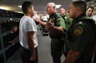 Edgar Delgado is talked to by instructor Roland Renaud while Delgado and other new trainees are fitted for uniforms, boots and hats at the United States Border Patrol Academy on Thursday August 30, 2018 in Artesia, NM. The academy is on the grounds of the Federal Law Enforcement Training Center.