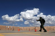 Miranda Shields takes her turn on the shooting range at the United States Border Patrol Academy on Wednesday August 29, 2018 in Artesia, NM. The academy is on the grounds of the Federal Law Enforcement Training Center.