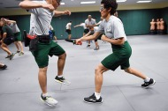Felipe Chavez, left, jumps away from Silvia Gutierrez Gomez as they take part in edge weapons training at the United States Border Patrol Academy on Thursday August 30, 2018 in Artesia, NM. The academy is on the grounds of the Federal Law Enforcement Training Center.