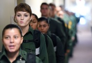 Erin Herrgott, 20, of Oxford, MI, top left, lines up with fellow new trainees at the United States Border Patrol Academy on Friday August 31, 2018 in Artesia, NM. The academy is on the grounds of the Federal Law Enforcement Training Center.