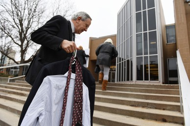Gary Benjamin carries spare clothes for Ansly Damus after Gary and others rode a bus from Cleveland, OH in order to attend a hearing for Damus at the Ann Arbor Federal Building on Wednesday November 28, 2018 in Ann Arbor, MI. Damus, who is from Haiti has been detained since 2016 after coming to the United States to seek asylum. Ansly was released on Friday to live with Benjamin and his wife, Melody Hart.