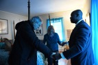 Gary Benjamin and his wife, Melody Hart pray with Ansly Damus as they stand in Ansly's room at their home on Friday November 30, 2018 in Cleveland Heights, OH. Damus, who is from Haiti has been detained since 2016 after coming to the United States to seek asylum. Ansly was released on Friday to live with Benjamin and Hart.