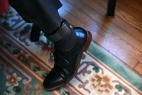 Ansly Damus wears an ankle monitor as he sits in the home of Gary Benjamin and his wife, Melody Hart on Friday November 30, 2018 in Cleveland Heights, OH. Damus, who is from Haiti has been detained since 2016 after coming to the United States to seek asylum. Ansly was released on Friday to live with Benjamin and Hart.