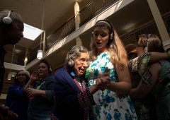 "2nd Place Feature: Kaitlin McKeown, Virginian-Pilot---Norma Agee wears headphones while dancing with Kendall Ramirez, program director at Commonwealth Senior Living's Leigh Hall, during a ""silent dance party"" on Oct. 30, 2018 in Norfolk. Residents wore headphones designed to eliminate extraneous noise and help senior citizens with hearing loss."
