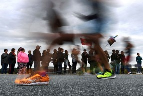 3rd Place Sports: Matt McClain, Washington Post---Runners are blurred while passing not far from the Lincoln Memorial during the annual Marine Corps Marathon on Sunday October 28, 2018 in Washington, DC.