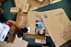 HM Feature: Jonathon Gruenke, Daily Press---Three-year-old Jonas Brin, center, plays in boxes at the Virginia Living Museum Monday during their Stellar Noon Year's Eve event December 31, 2018. The outer space themed event featured crafts, games, Star Wars characters and activities aimed at teaching to reduce environmental impact.